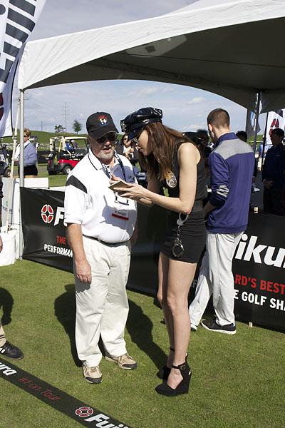 """""""Book 'em, Danno!"""" Christine Morse greets a Demo Day attendee at the Fujikura Golf tent."""