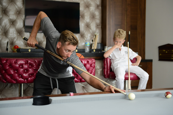 "After beating Luke in pool, Ian told his son, ""You need to learn to win. No one is going to hand it to you."""