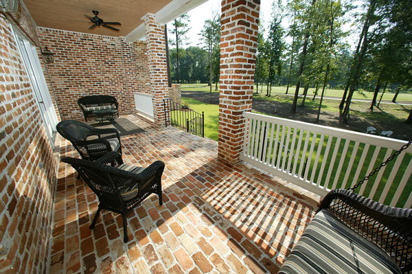 The home features a porch with golf course views.