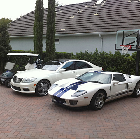 Poulter's collection also includes a white Ford GT with blue racing stripes.