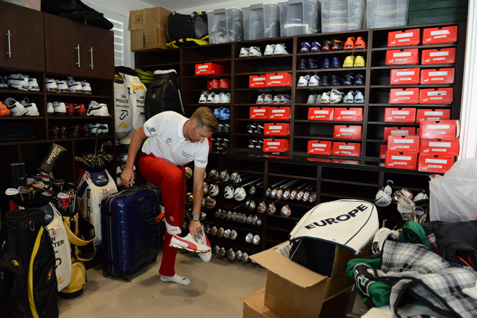 "Poulter's ""golf studio"" occupies two of his six garage bays. ""It's like a tour van without wheels,"" he says. There is an indoor hitting area with cameras and a launch monitor, a grinding wheel to work on his wedges, and various other contraptions for tuning his clubs."