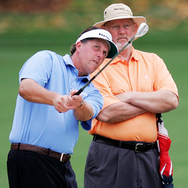Phil Mickelson works on the range under the eye of his short-game guru Dave Pelz.