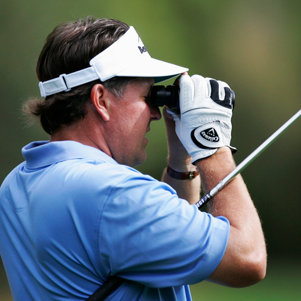 Phil Mickelson checked his yardage on the range Wednesday morning at Augusta National.