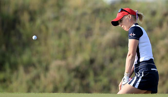 Morgan Pressel plays a shot on the fourth hole Saturday morning. Pressel and Jessica Korda lost to Anna Nordqvist and Caroline Hedwall.