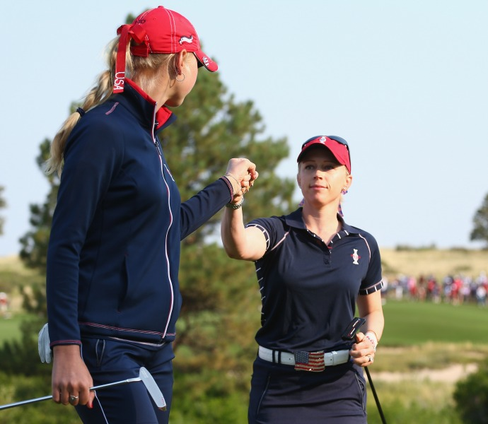 Morgan Pressel and Jessica Korda celebrate after a shot on the 2nd hole.
