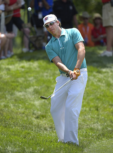 Ricky Barnes hits a chip shot on the third green during the third round of the Quicken Loans National at Congressional Country Club.