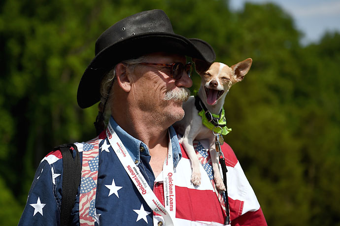 Sam Daugherty, and his dog, Rocket J. Squirrel, pose for a portrait during the third round of the Quicken Loans National at Congressional Country Club.