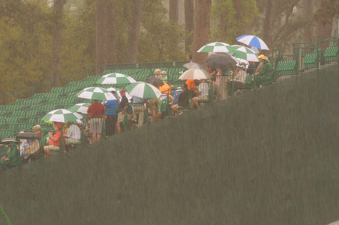 Patrons waited out a passing shower on Friday morning.