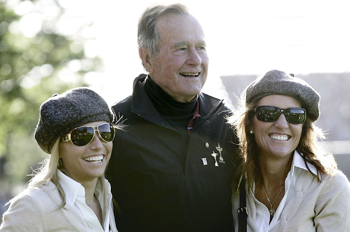 Former President George Bush, Amy Mickelson and Amy DiMarco at the 2006 Ryder Cup at Ireland's K Club.