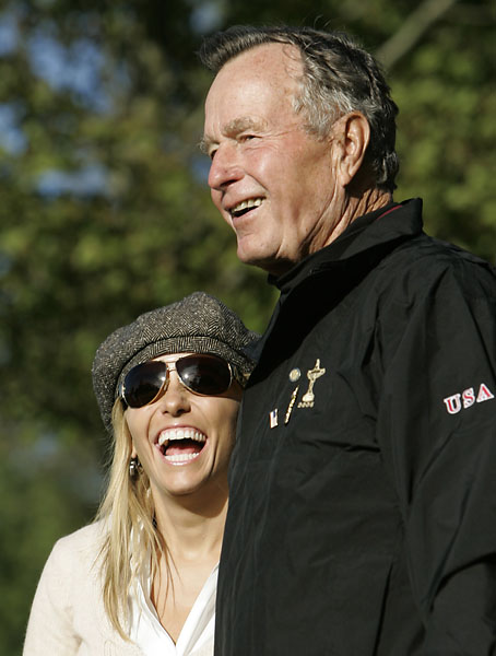 Amy Mickelson laughs with former President George Bush as they watch the fourball match Phil Mickelson and Chris DiMarco and Lee Westwood and Darren Clarke on the first day of the 2006 Ryder Cup at the K Club golf course, Straffan, Ireland.