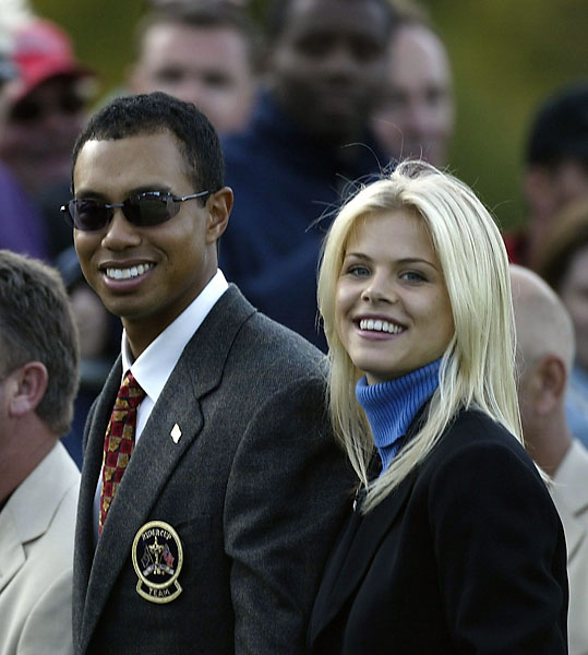 Tigers Woods and then girlfriend Elin Nordegren during the opening ceremony for the 2002 Ryder Cup at the Belfry in Sutton Coldfield, England on Sept. 26, 2002.