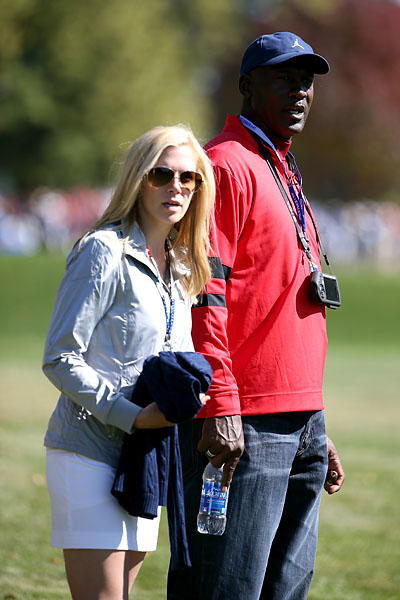 Michael Jordan and Dowd Simpson watch Webb Simpson during the 2012 Ryder Cup at Medinah Country Club.