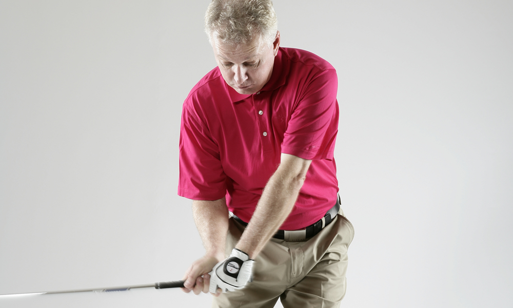 """Learn to hit the golf ball and then the earth. All good players hit what I call 'ball- divot,' which means the handle is forward of the clubhead at impact, or the shaft is leaning just a bit toward the target. This means the player is hitting downward on the ball, which promotes more distance, more backspin, and more consistent shots. Learning this one thing WILL make you a better golfer and lower your scores!""                           Steve Bosdosh, Members Club at Four Streatms, Beallsville, Md.                           See Steve's tip on how to master 60-yard pitch shots here."