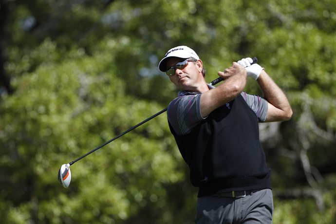 Retief Goosen shot himself out of the tournament with an eight-over 80.