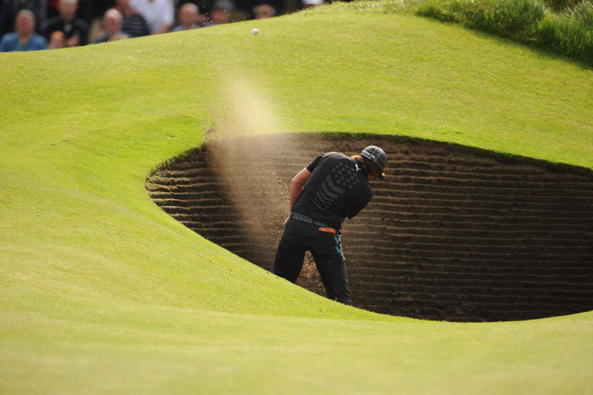 Rickie Fowler found one of the 206 bunkers at Royal Lytham and St. Annes on Friday. He shot 72 and is three over.