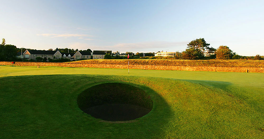 If there really are 1,000 places to see before you die, then there's got to be at least 18 must-play holes you need to tee it up on during your lifetime. Travelin' Joe Passov has identified those and tells you what elements make each one so notable.1. St. Andrews (Old Course) -- No. 17: Par 4, 455 yards -- St. Andrews, ScotlandIf this isn't the most famous hole in golf, it is unquestionably the most unique. The properly positioned (blind) drive must actually carry a portion of the Old Course Hotel. The further right you go, the better your angle into the green -- except that OB lurks hard right. The Road Hole earns its name from a pebbled road that awaits a long approach, literally at the green's edge (and a stone wall behind the road). On the other side of the green is the deep, stacked-sod pit known as the Road Hole bunker. The quirkiest, toughest hole on golf's oldest course is unforgettable.