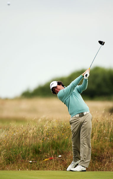 Rory McIlroy tees off during the practice round on Monday. The young Northern Irishman is among the top players in betting odds to win at Turnberry.