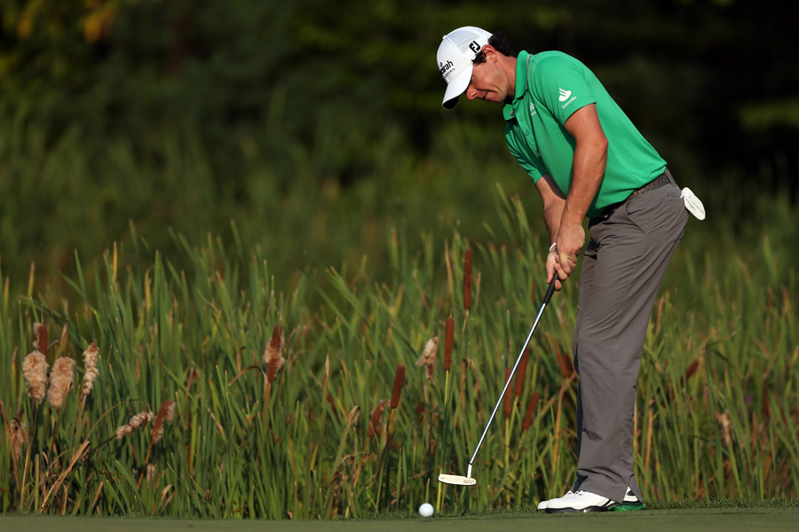 Rory McIlroy birdied two of the last four holes for a six-under 65.