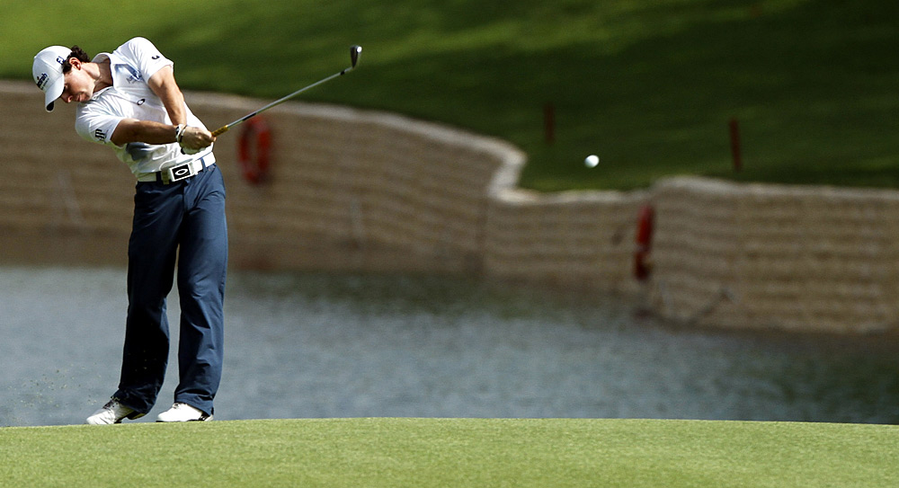 Rory McIlroy birdied three out of four holes before play was suspended due to rain on Friday.
