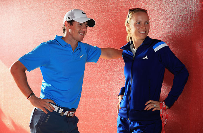 Rory McIlroy and Caroline Wozniacki got engaged on Dec. 31, 2013 during a New Year's Eve celebration in Australia. Here, Rory and Caroline talk after Rory finished second after the final round of the Abu Dhabi HSBC Golf Championship in January 2014.