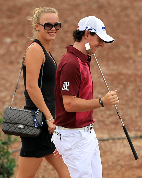 Rory McIlroy and Caroline Wozniacki started dating in 2011, the same year McIlroy won the U.S. Open, his first major championship. In this photo Wozniacki and McIlroy chat during the third round at Dubai Golf World Championship in November 2012.