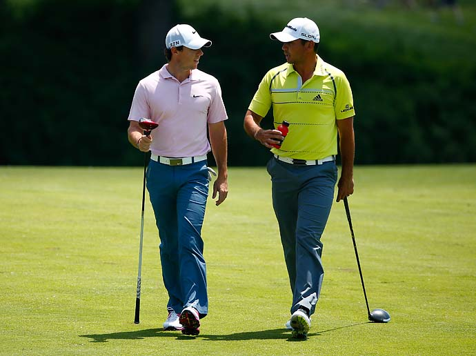 Rory McIlroy and Jason Day walk down the 10th hole during the third round of the Memorial Tournament. McIlroy shot 69 and Day shot 70.