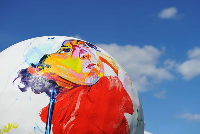 If having a painting of yourself on a giant golf ball is good luck, then Rory McIlroy could be a good pick this week.