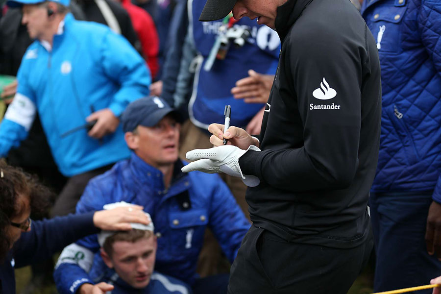 Rory McIlory signed his glove after hitting this fan with a drive on Thursday. McIlroy also paid for the fan's hotel room and a dinner.