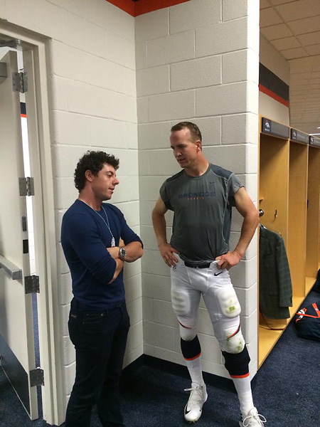 Rory McIlroy and Peyton Manning talk in the Bronco locker room Sunday night.