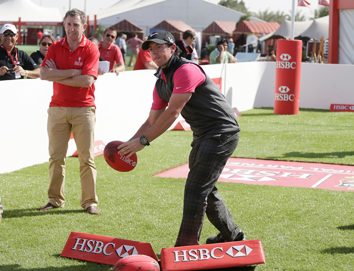 After his round, McIlroy passed a rugby ball in the spectator village with Welsh rugby legend Jonathan Davies.