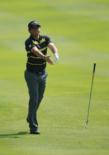 McIlroy let his frustrations out after he threw a club on the 12th hole.