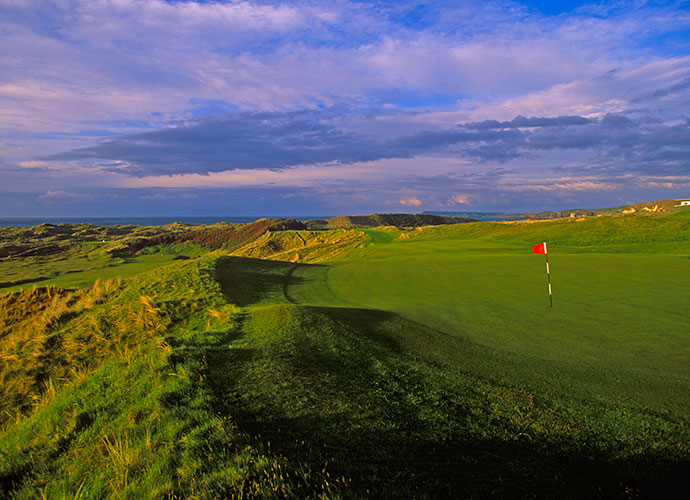Royal Portrush Golf Club in Portrush, Northern Ireland: Another world-class links and host of the 2012 Irish Open, Royal Portrush is one of Ireland's most stunning golfing venues. I could mention every hole in detail (I shot 61 here as a 16-year-old in an amateur open event) but Calamity Corner, the 210 yard par-3, must be played to be appreciated.  With the wind blowing in from the North Antrim coast, this is not a hole for the faint-hearted! In almost every sense, Royal Portrush is a truly awe-inspiring experience.