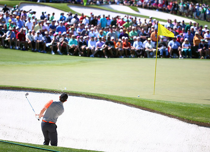 Rory McIlroy chips out of the sand on No. 2.