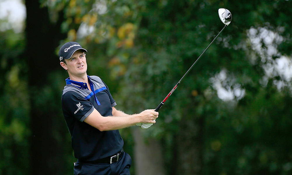 Justin Rose fired a 66 to tie Woods for the lead.
