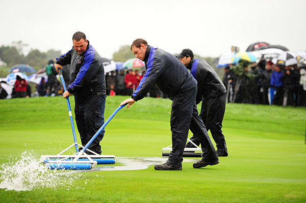 Grounds crew workers tried in vain to squeegee the course. Play was suspended with the first match through five holes.