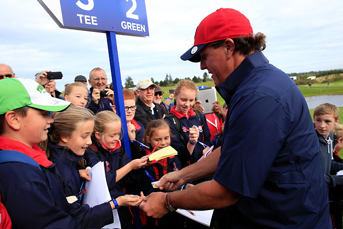 Phil Mickelson signs autographs during practice Wednesday at the 2014 Ryder Cup in Gleneagles, Scotland.