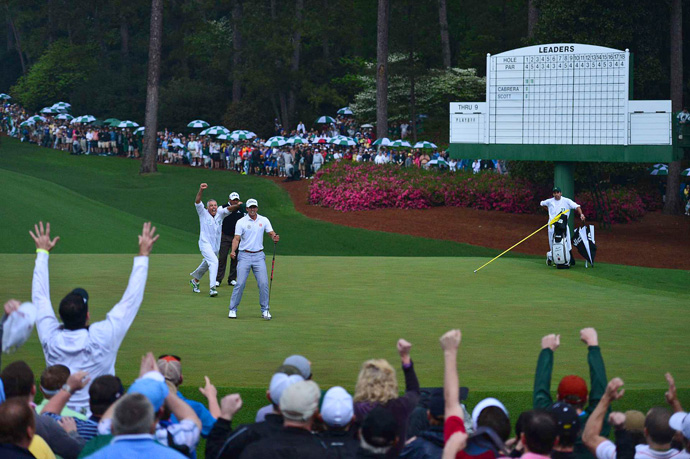 Adam Scott beat Angel Cabrera on the second hole of a playoff to win his first major championship.