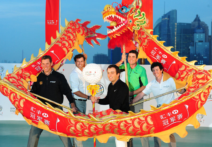 From left to right: Westwood, Adam Scott, Francesco Molinari, Keegan Bradley and McIlroy performed a traditional dragon dance on the historic Bund in Shanghai before the 2011 WGC-HSBC Champions.