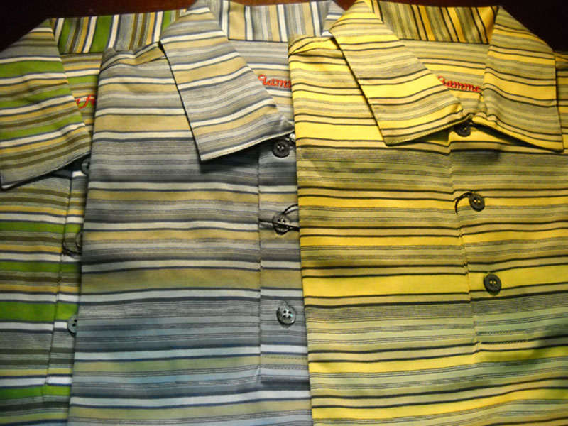 "In fiamme polos                       Somewhat unique among golf shirts in that they bear no logos, In fiamme polos have a European heritage and name (in fiamme is Italian for ""on fire""). Handmade in Milan of a silky North African cotton, the shirts have self collars (same material and pattern as the shirt body) and mother-of-pearl buttons. ($120-$160)"