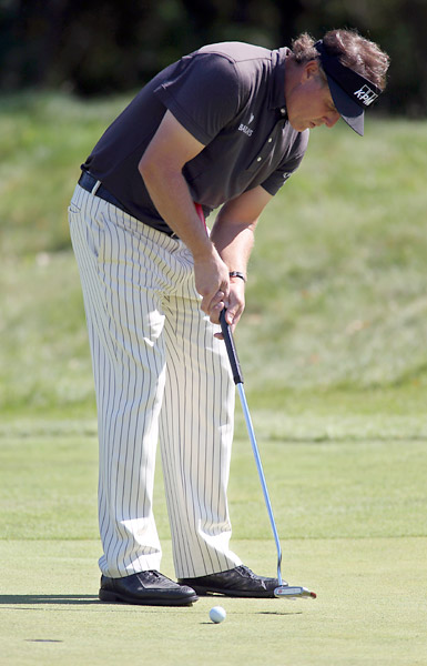 Mickelson wielded a belly putter in competition for the first time on Friday.