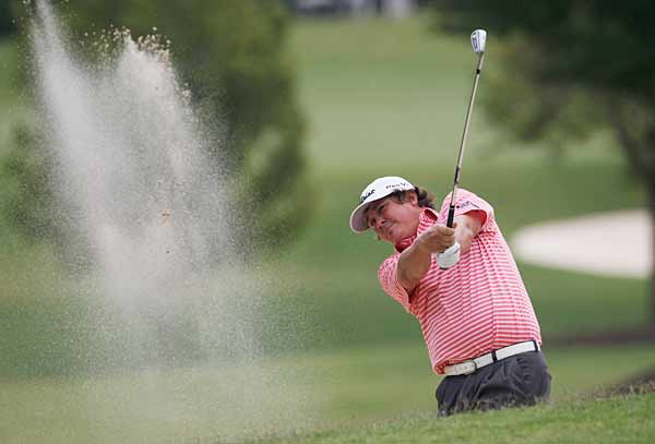 Jason Dufner, the man who lost to Bradley in a playoff at the PGA, had a bogey-free round to get to four under.