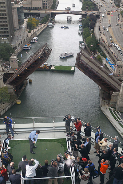 Earlier, the captains hit balls off Trump International Tower with a floating green in the Chicago River as a target.