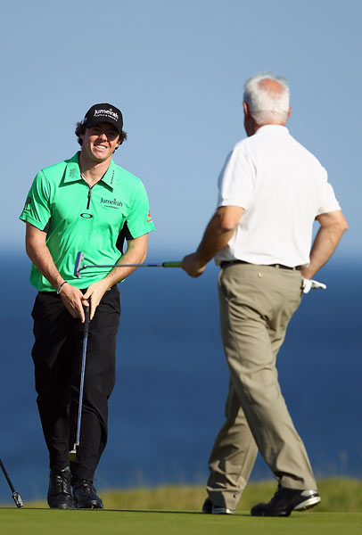 U.S. Open champ Rory McIlroy played alongside his father, Gerry McIlroy (right), in the first round at Kingsbarns.