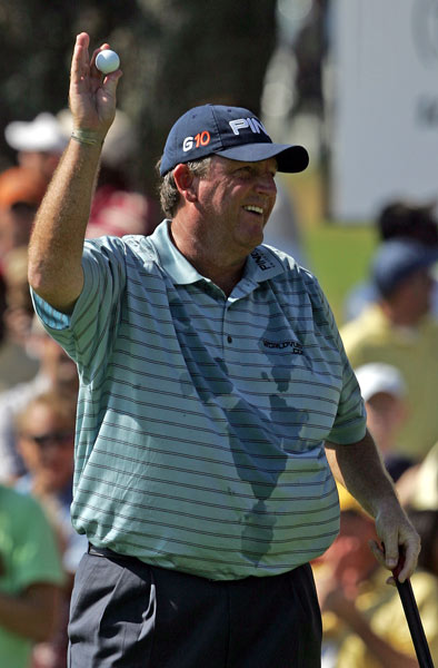 Mark Calcavecchia tied Woods for the lead after an eagle on No. 15. Calcavecchia then bogeyed 16 and finished three behind Woods.