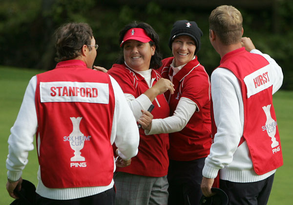 Solheim Cup: Day Two                                                      Pat Hurst, second left, with teammate Angela Stanford, second right, celebrated with their caddies after defeating Europe's Iben Tinning of Denmark and Betina Hauert of Germany in their morning foursome match.