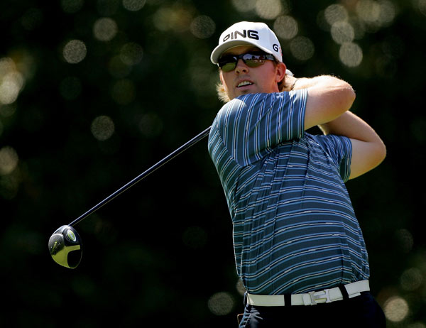 Hunter Mahan made an eagle on 15 to move within seven shots of Woods.