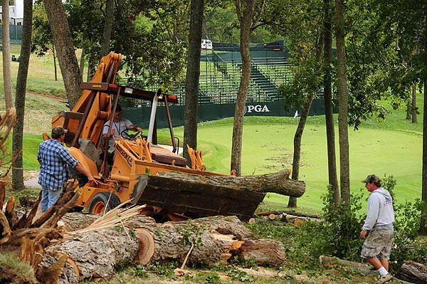Crews spent Monday morning cleaning up fallen trees that littered the course after Hurricane Ike swept through the Ryder Cup site.