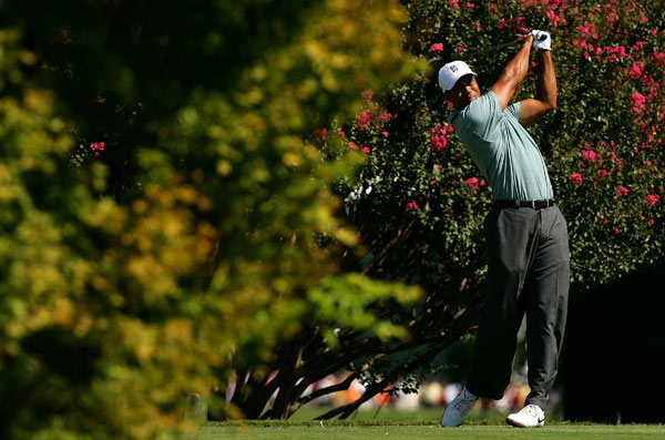 Round 3 at the Tour Championship                                              Tiger Woods started the day with a three-shot lead, and that's how he finished it after a six-under 64.