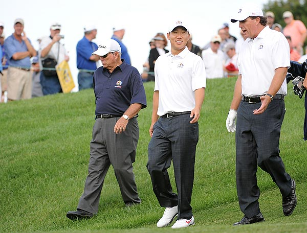 Ryder Cup Preview: Tuesday                             Ryder Cup rookie Anthony Kim and veteran Phil Mickelson, here with swing coach Butch Harmon, far left, played their first practice round on Tuesday.