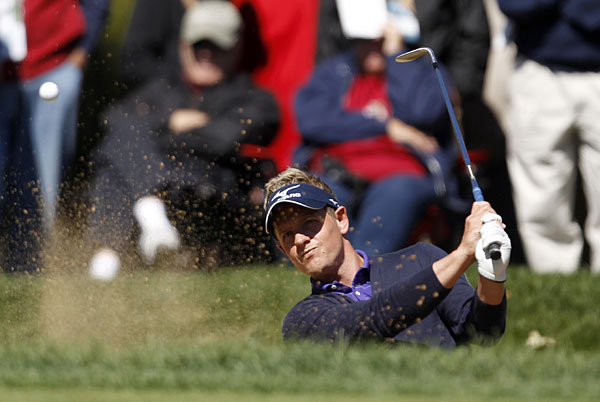 Luke Donald rebounded from an opening 75 with a 66 on Friday.